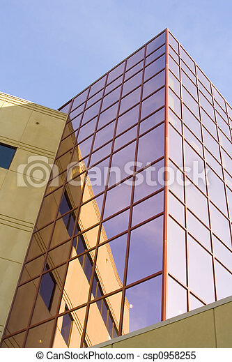 Tall office building with reflective pink glass windows - csp0958255