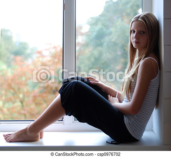 Young model sitting on the window-sill - csp0976702