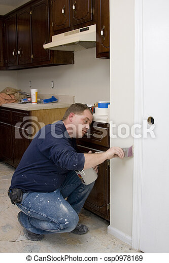 Painter painting trim around doors & windows - csp0978169