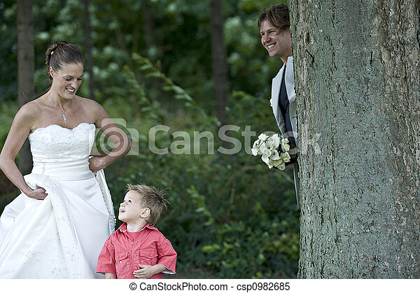Groom playing hide and seek with his son - csp0982685