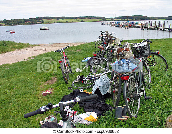 Stack of bicycles by the beach - csp0988852
