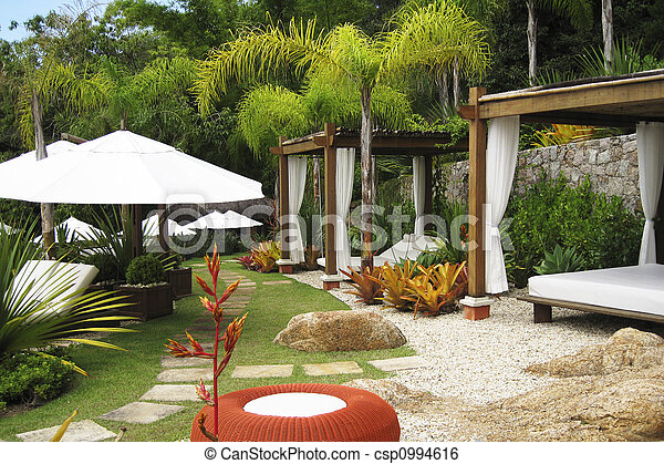 Hotel garden with beds and parasols