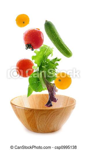 Fresh vegetables falling - csp0995138