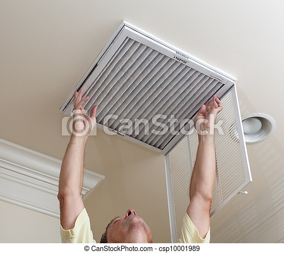 Senior man opening air conditioning filter in ceiling - csp10001989
