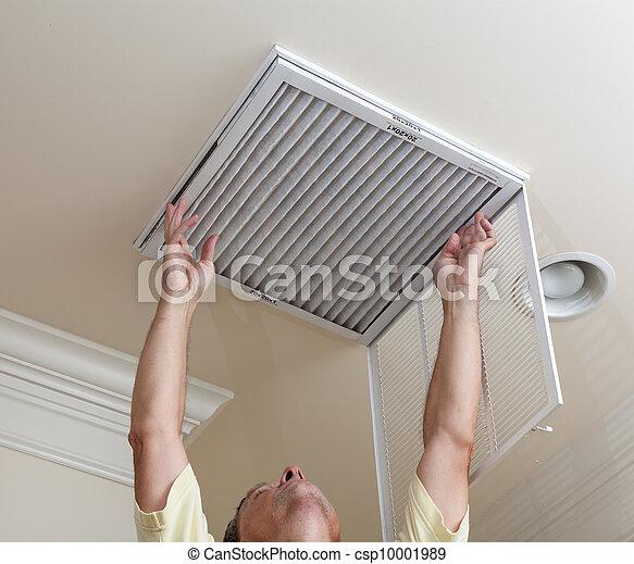 Senior man opening air conditioning filter in ceiling - csp10001989