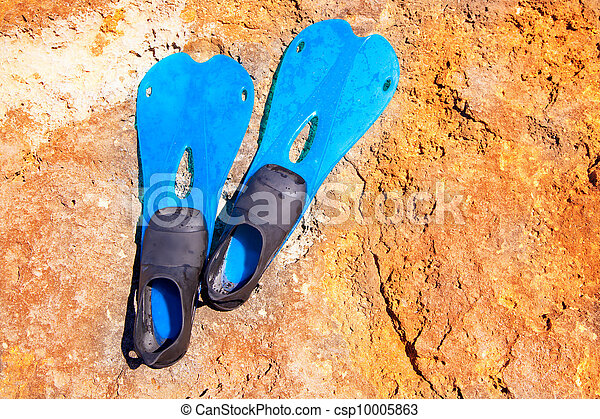 blue scuba diving fins on summer day over rock - csp10005863