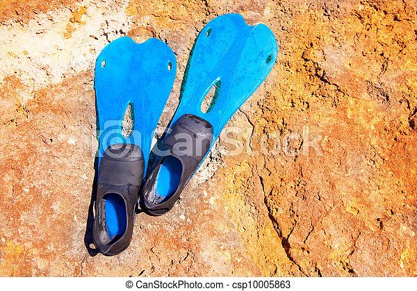 blue scuba diving fins on summer day over rock - csp10005863