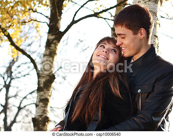 Happy young couple in love having fun autumn park - csp10006540