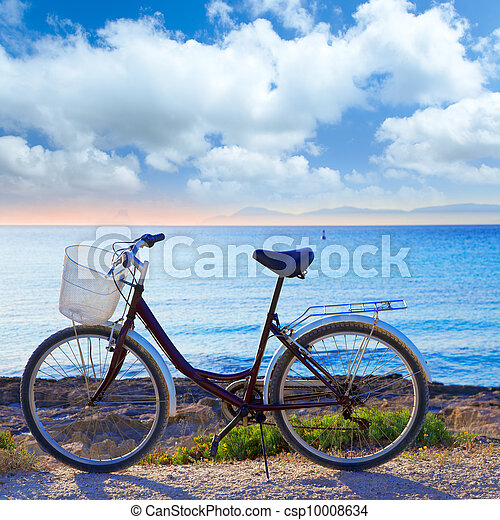 Bicycle in formentera beach with Ibiza sunset - csp10008634