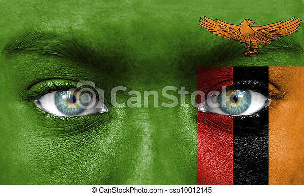 Human face painted with flag of Zambia - csp10012145