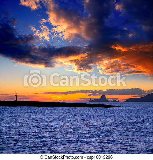 Ibiza island sunset with Es Vedra and Gastabi islet - csp10013296