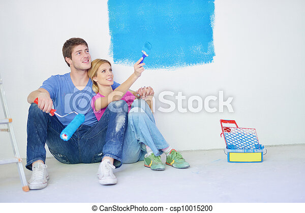 happy young cople relaxing after painting in new home - csp10015200