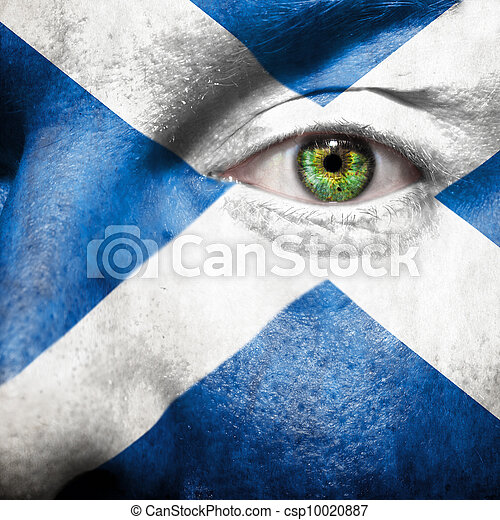Flag painted on face with green eye to show Scotland support - csp10020887