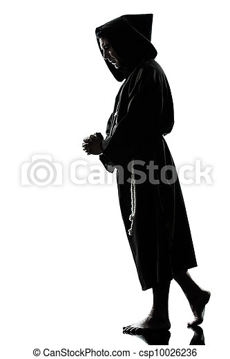 man monk priest silhouette praying - csp10026236