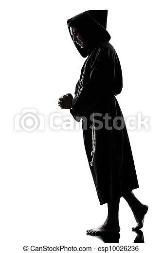 man monk priest silhouette praying - csp10026236