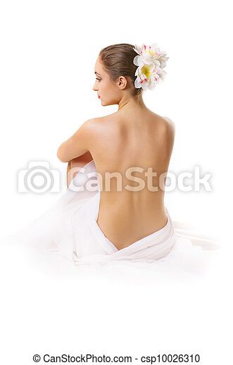 young woman, sitting with a bare back.  - csp10026310