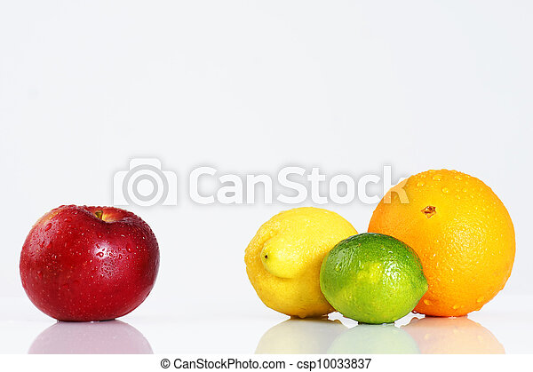 Apple compared to citrus fruits over white - csp10033837