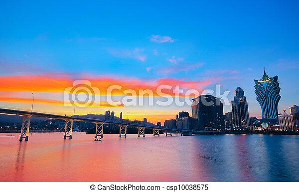 Macao cityscape with famous landmark of casino skyscraper and bridge - csp10038575