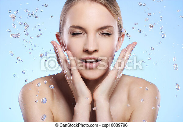 Beautiful woman washing her face - csp10039796