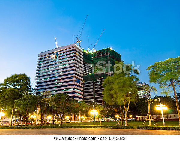 night shot of construction site with tower crane loader - csp10043822