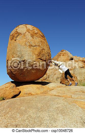 Sisyphus woman pushing boulder