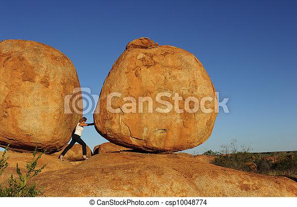 Woman pushing boulder