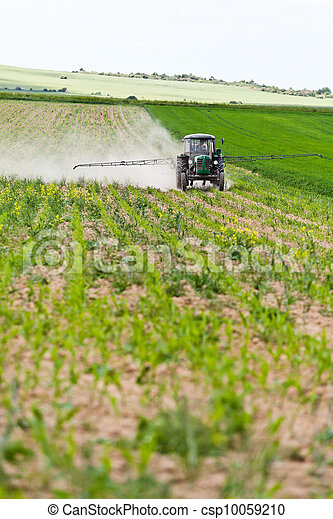 Tractor spraying, agriculture - csp10059210
