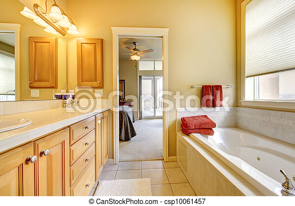 Bathroom with wood cabinets and tub. - csp10061457