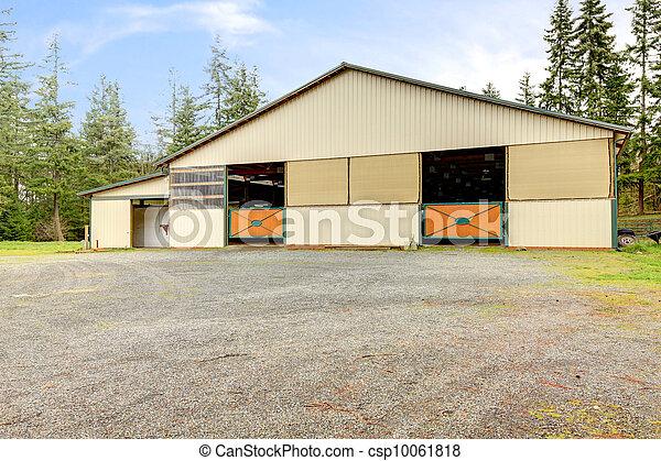 Horse arena exterior building with two lareg gates. - csp10061818