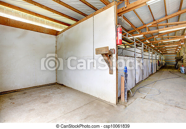 Horse arena interior with ashing area and stables. - csp10061839