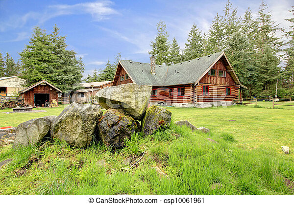 Classic old log cabin house in the country side. - csp10061961