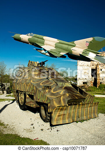 Military vehicle and MIG 21 airplane  - csp10071787