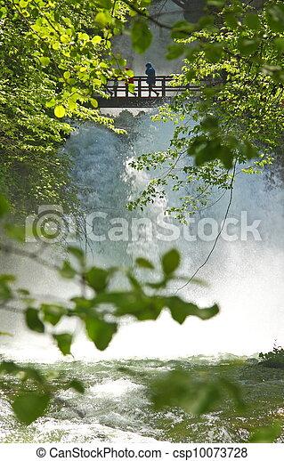 Wooden bridge over the waterfalls - csp10073728