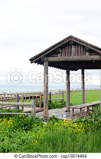 Wooden pavilion and fence in the grassland - csp10074464