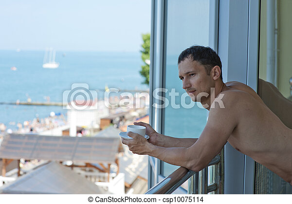 young handsome man at hotel at tropics - csp10075114