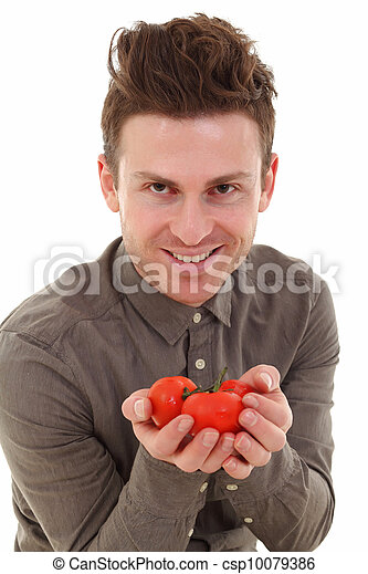 Young man offering tomatoes - csp10079386