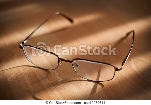 Eyeglasses on warm background  - csp10079611