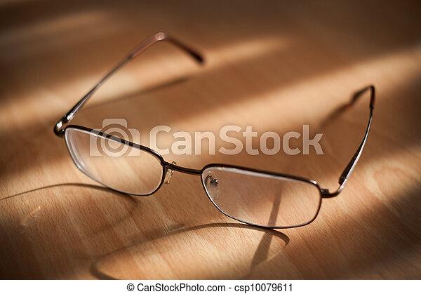 Eyeglasses on warm background  - csp10079611
