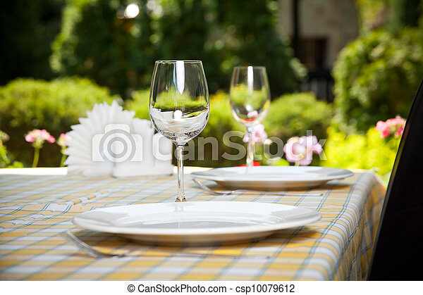 Outdoor restaurant dining table - csp10079612