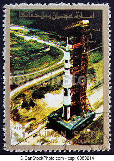 Postage stamp Ajman 1973 Roll out of Saturn 5 on launch pad