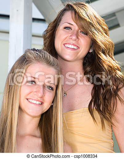 Portrait of Beautiful Sisters - csp1008334