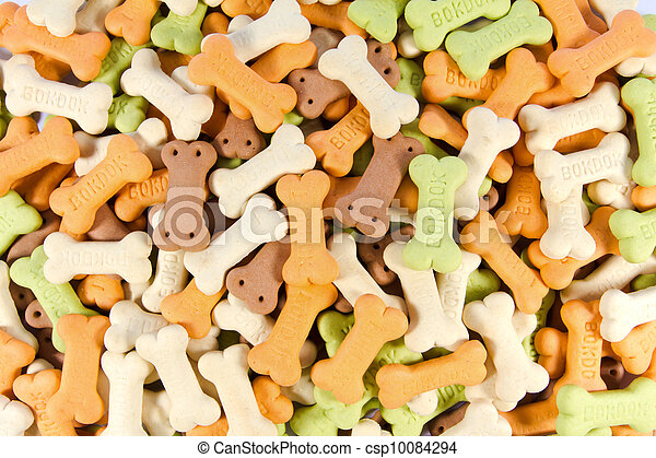 Backgrounds of color full bone shaped dog treats - csp10084294