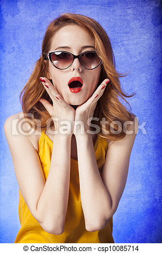American redhead girl in sunglasses. Photo in 60s style. - csp10085714