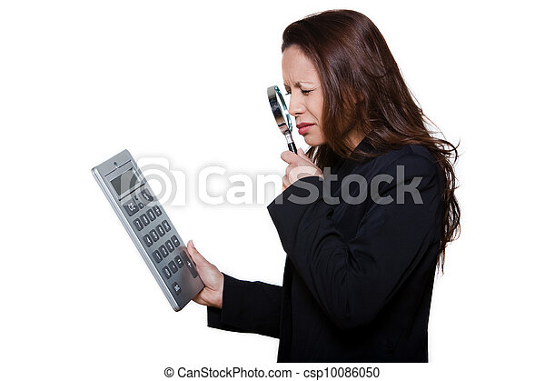 Portrait of visually handicapped woman using magnifying glass to see large calculator isolated on background - csp10086050
