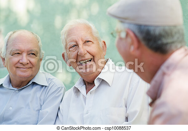 Group of happy elderly men laughing and talking - csp10088537