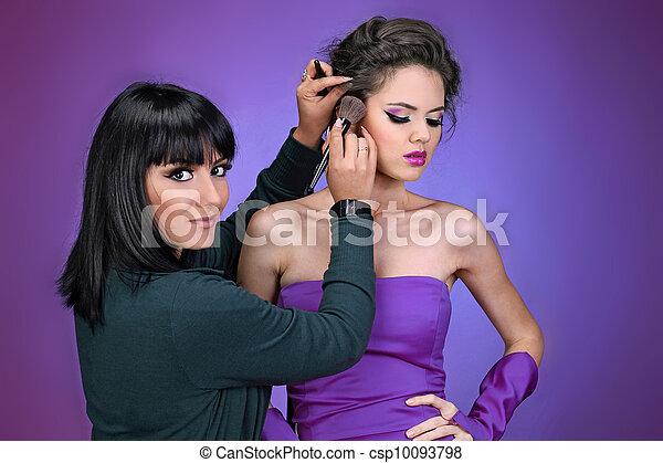 Professional Make-up artist doing model makeup at work - csp10093798