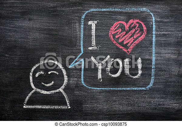 Speech bubble with a cartoon figure, saying I love you drawn on a blackboard background - csp10093875