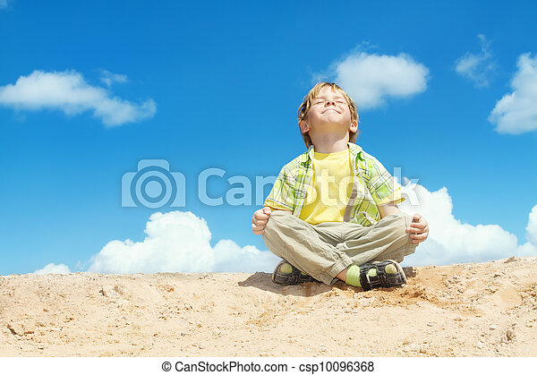 Happy child sitting in lotus position over bllue sky on the top. Happiness and freedom concept. - csp10096368