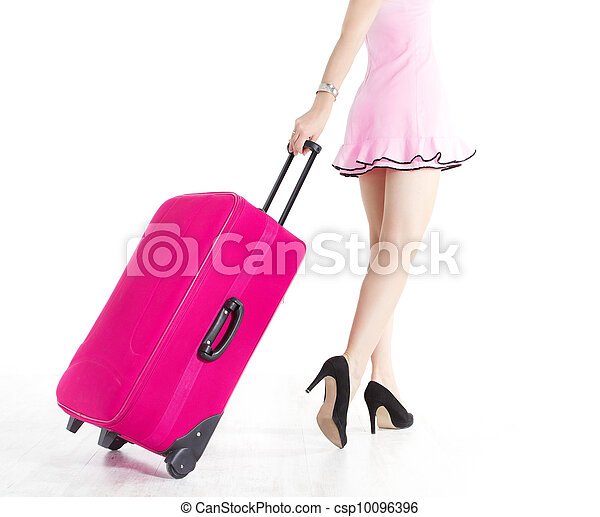 Woman legs going and pulling vacation suitcase - csp10096396