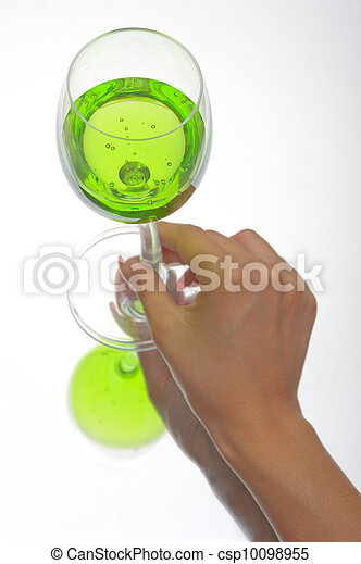 Hand holding glass of green fluid - csp10098955